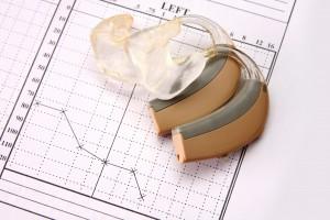 medical chart and hearing aid