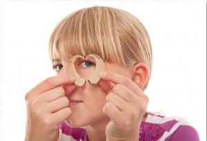 woman looking through hearing aids